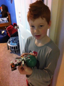 Holding one of his latest Lego creations.  Happy Birthday Brody!