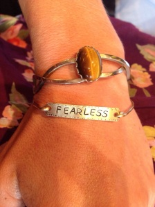 My @bama_ry bracelet with my new motto - paired with my great-grandmother's cat's eye bracelet.